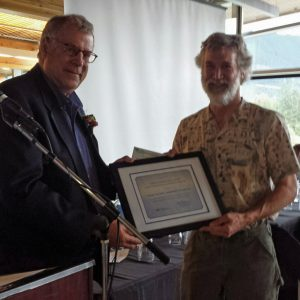 Minister Thomson presented the first award to John Stace-Smith from the Likely Xatsull Community Forest